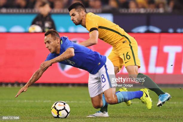 Aziz Behich of Australia competes for the ball over Marcio Souza of Brazil during the Brasil Global Tour match between Australian Socceroos and...