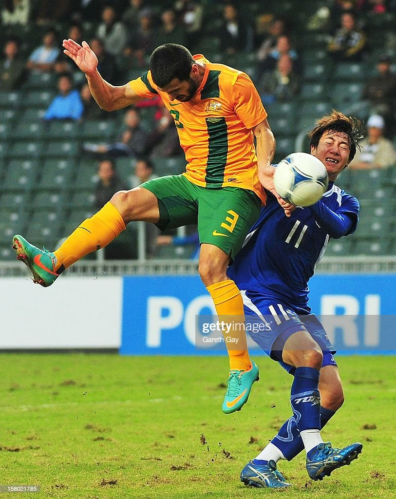 Aziz Behich (L) of Australia competes for the ball with Chen Po Hao of Chinese during the EAFF East Asian Cup 2013 Qualifying match between Chinese Tapei and the Australian Socceroos at Hong Kong Stadium on December 9, 2012 in So Kon Po, Hong Kong.