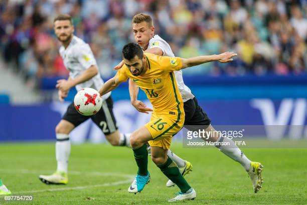 Aziz Behich of Australia competes with Joshua Kimmich of Germany during the FIFA Confederations Cup Russia 2017 group B football match between...