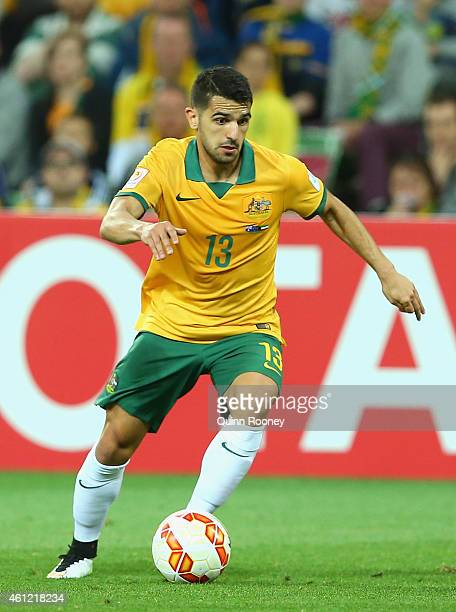 Aziz Behich of Australia looks to pass the ball during the 2015 Asian Cup match between the Australian Socceroos and Kuwait at AAMI Park on January 9...