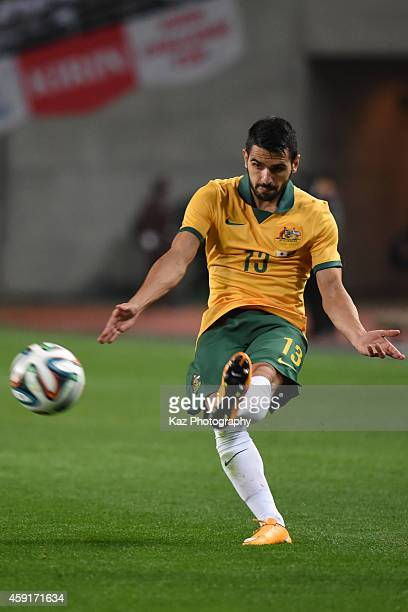 Aziz Behich of Australia passes the ball during the international friendly match between Japan and Australia at Nagai Stadium on November 18 2014 in...