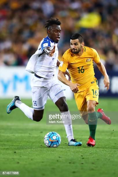 Aziz Behich of Australia runs th ball past Alberth Elis of Honduras during the 2018 FIFA World Cup Qualifiers Leg 2 match between the Australian...