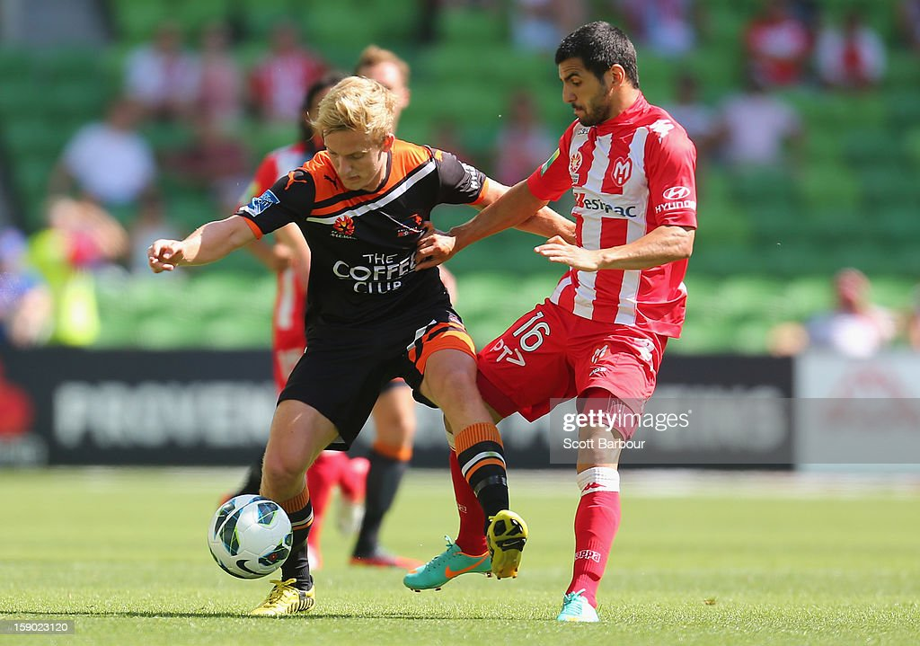 Aziz Behich of the Heart and Ben Halloran of the Roar compete for the ball during the round 15 A-League match between the Melbourne Heart and the Brisbane Roar at AAMI Park on January 6, 2013 in Melbourne, Australia.