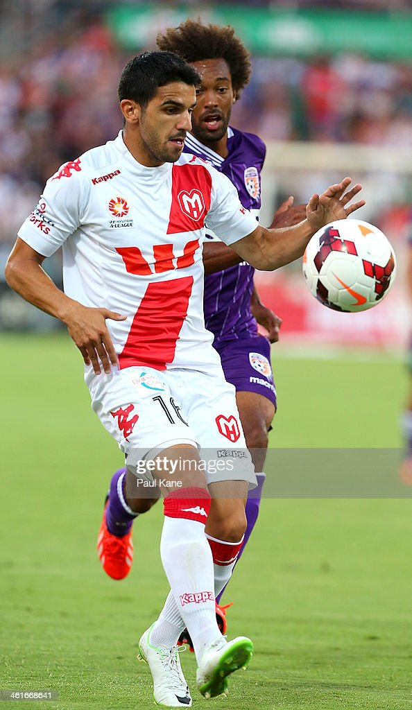 Aziz Behich of the Heart and Isaka Cernak of the Glory contest for the ball during the round 14 A-League match between Perth Glory and the Melbourne Heart at nib Stadium on January 10, 2014 in Perth, Australia.