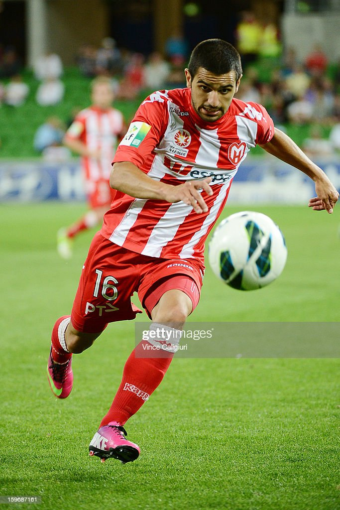 Aziz Behich of the Heart attacks the ball during the round seventeen A-League match between Melbourne Heart and Adelaide United at AAMI Park on January 18, 2013 in Melbourne, Australia.