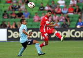 Aziz Behich of the Heart get a pass away under pressure during the round 17 ALeague match between Melbourne Heart and Sydney FC at AAMI Park on...