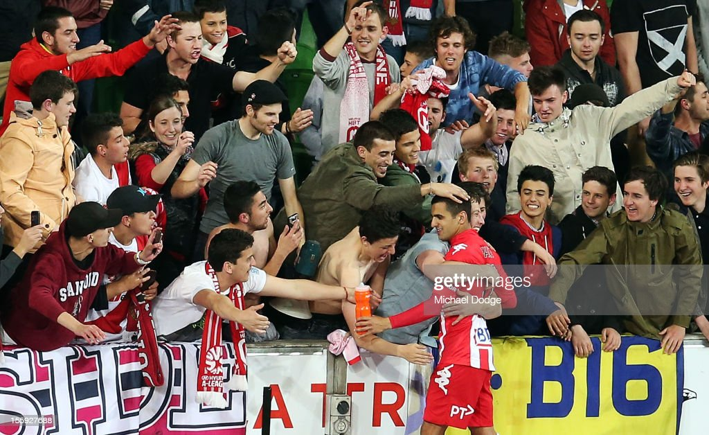 Aziz Behich of the Heart gets hugged by the fans after the round six A-League match between the Melbourne Heart and the Brisbane Roar at AAMI Park on November 9, 2012 in Melbourne, Australia.