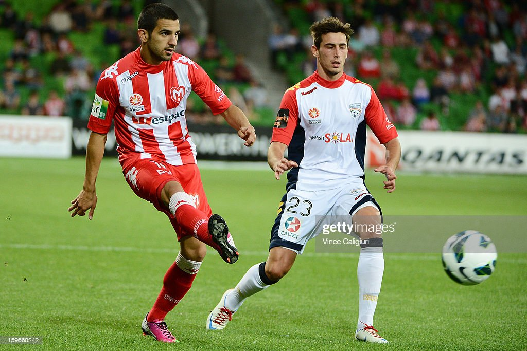 Aziz Behich of the Heart passes the ball away from Evan Kostopoulos of United during the round seventeen A-League match between Melbourne Heart and Adelaide United at AAMI Park on January 18, 2013 in Melbourne, Australia.