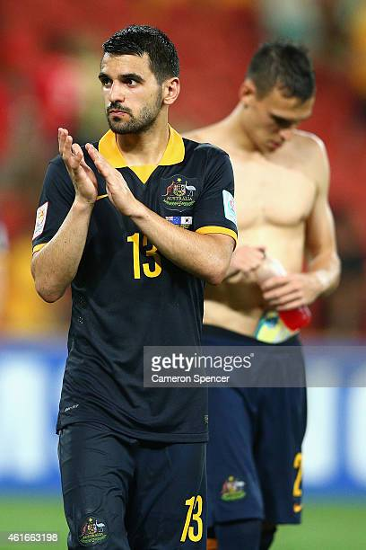 Aziz Behich of the Socceroos thanks the crowd following the 2015 Asian Cup match between Australia and Korea Republic at Suncorp Stadium on January...