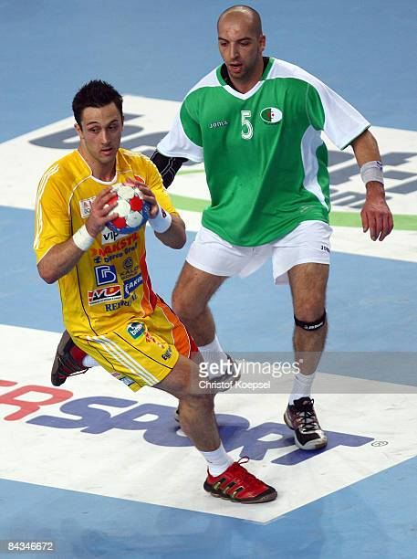 Aziz Benkahla of Algeria tackles Vladimir Temelkov of Macedonia during the Men's World Handball Championships match between Algeria and Macedonia at...