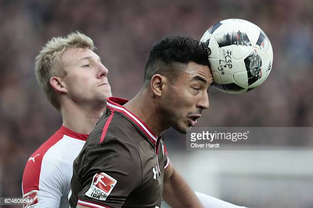 Aziz Bouhaddouz of Pauli and Axel Bellinghausen of Duesseldorf compete for the ball during the Second Bundesliga match between FC St Pauli and...
