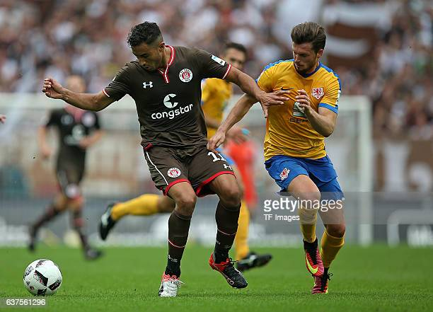 Aziz Bouhaddouz of Pauli and Quirin Moll of Braunschweig battle for the ball during the Second Bandesliga match between FC St Pauli and Eintracht...