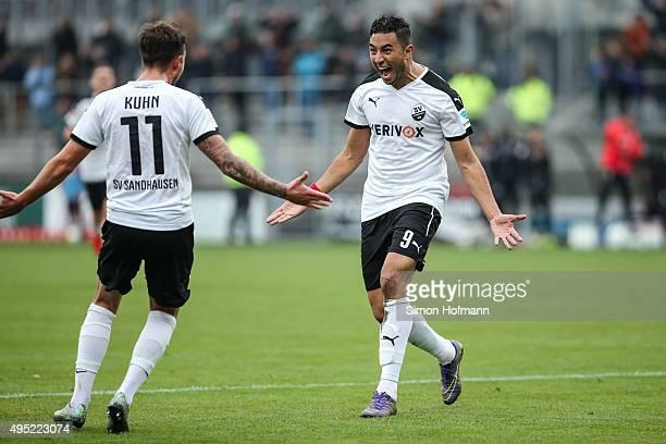 Aziz Bouhaddouz of Sandhausen celebrates his team's first goal with team mate Moritz Kuhn during the Second Bundesliga match between SV Sandhausen...
