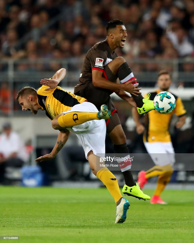 Aziz Bouhaddouz (R) of St. Pauli and Manuel Konrad of Dresden battlle for the ball during the Second Bundesliga match between FC St. Pauli and SG Dynamo Dresden at Millerntor Stadium on August 7, 2017 in Hamburg, Germany.