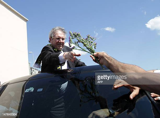 Aziz Yildirim president of Turkish football club Fenerbahce is greeted by supporters following his release despite being sentenced to six years and...
