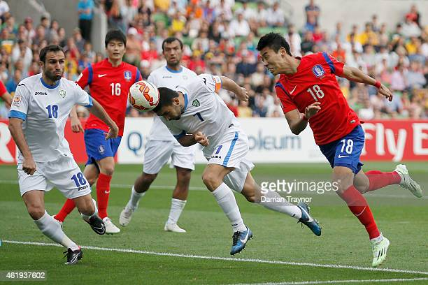 Azizbek Haydarov of Uzbekistan attempts to header a goal during the 2015 Asian Cup match between Korea Republic and Uzbekistan at AAMI Park on...