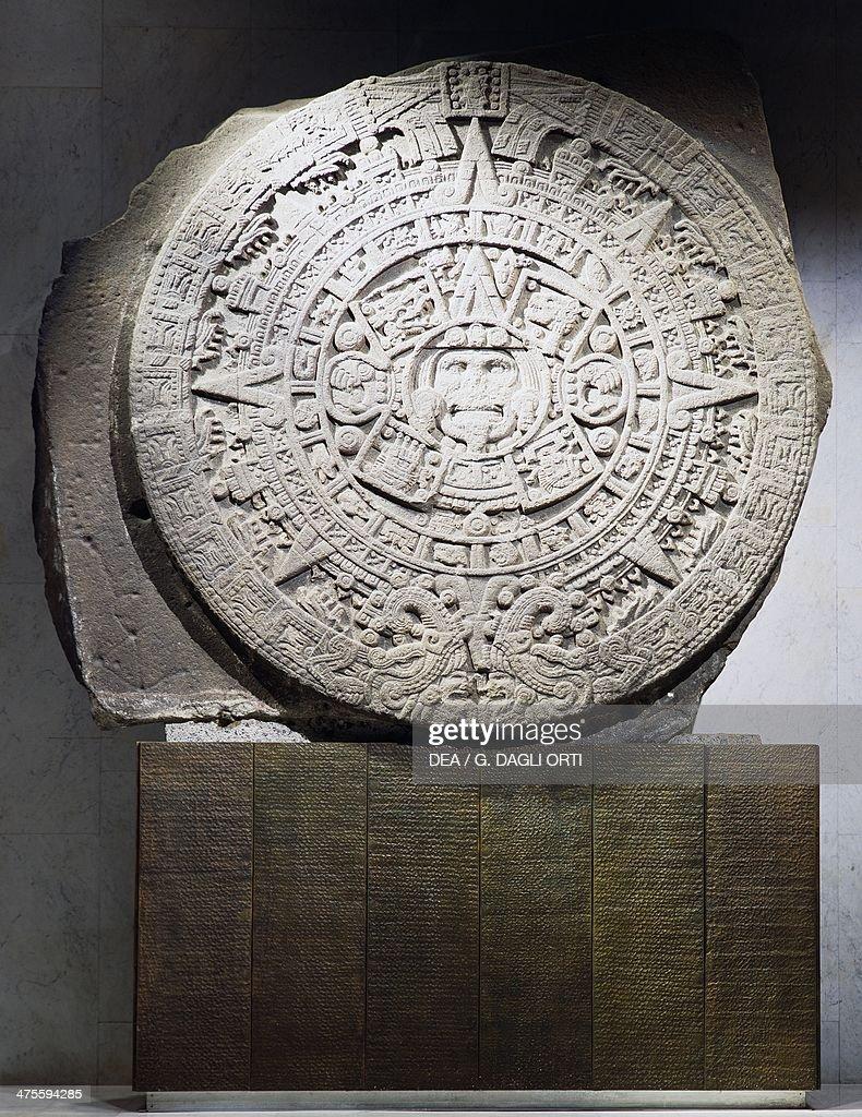 Aztec calendar or sun stone in basalt dating from the reign of Montezuma II Aztec civilisation 16th century Mexico City Museo Nacional De Antropología