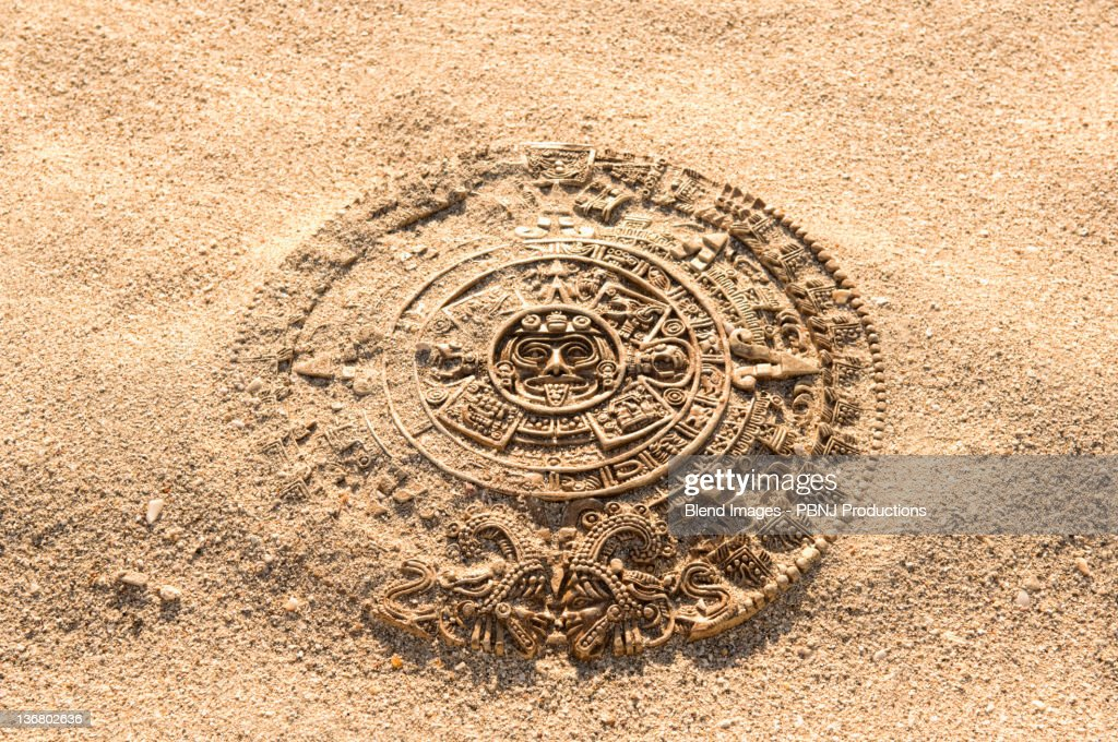 Aztec calendar stone carving on sand stock photo getty
