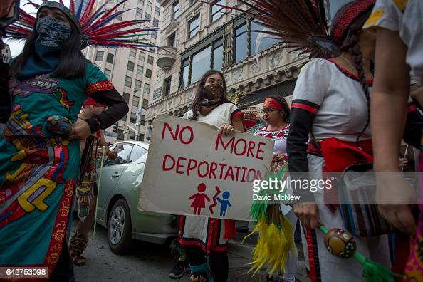 Aztec dancers participate in the Immigrants Make America Great March to protest actions being taken by the Trump administration on February 18 2017...