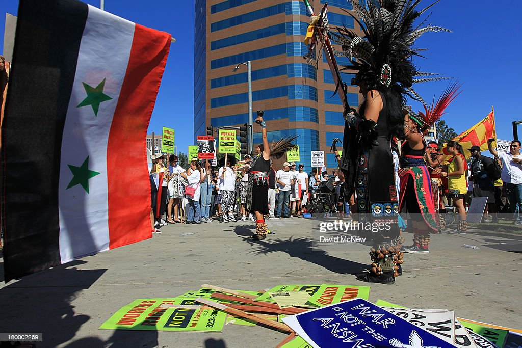 Aztec dancers perform at a rally to urge Congress to vote against a limited military strike against the Syrian military in response to allegations that President Bashar Hafez al-Assad has used sarin gas to kill civilians on September 7, 2013 in Los Angeles, California. The Obama administration claims to have clear evidence that the Syrian military broke international law by killing nearly 1,500 Syrian civilians, including at least 426 children, in a chemical weapons attack on August 21, and is seeking the support of Congress for a missile strikes to prevent future chemical weapons attacks by the regime and other nations.