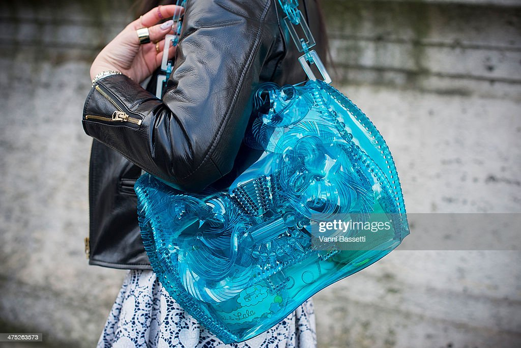 Azu Sato poses with a Beautiful People jacket, Undercover skirt and a Mame bag before Yang Li show on Day 2 of Paris Collections Womenswear Fall/Winter 2014-2015 at Palais des Beaux Arts on February 26, 2014 in Paris, France.