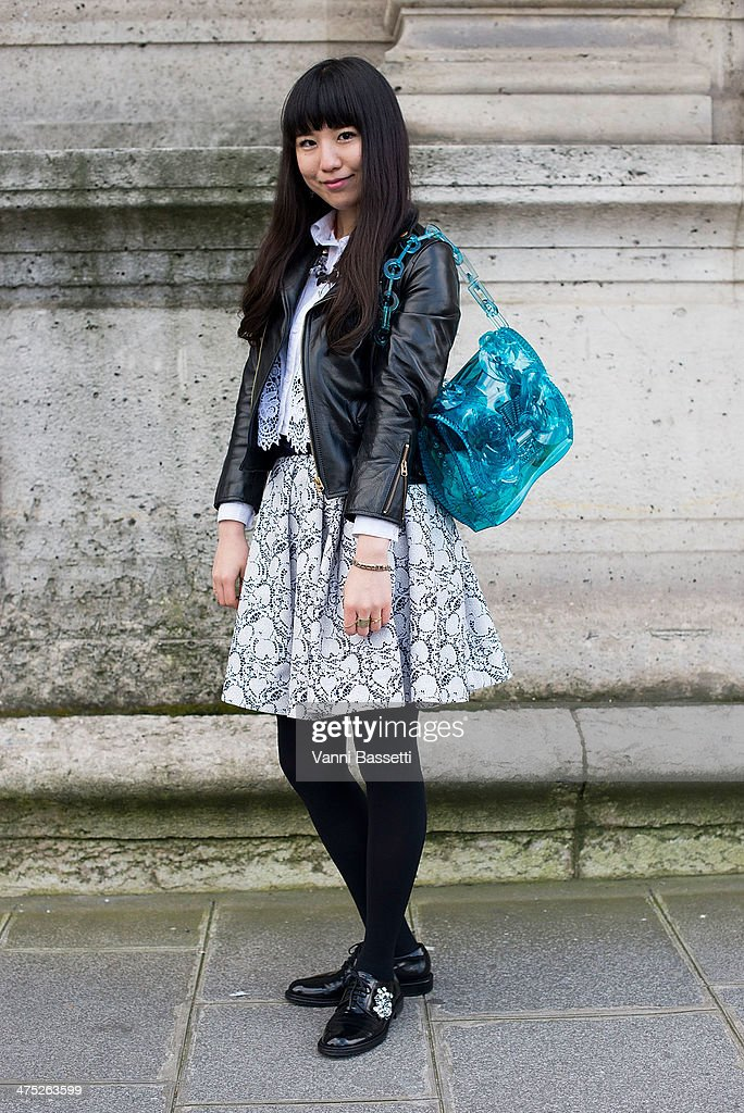 Azu Sato poses with a Beautiful People jacket, Undercover skirt, Mame bag and Pippi shoes before Yang Li show on Day 2 of Paris Collections Womenswear Fall/Winter 2014-2015 at Palais des Beaux Arts on February 26, 2014 in Paris, France.