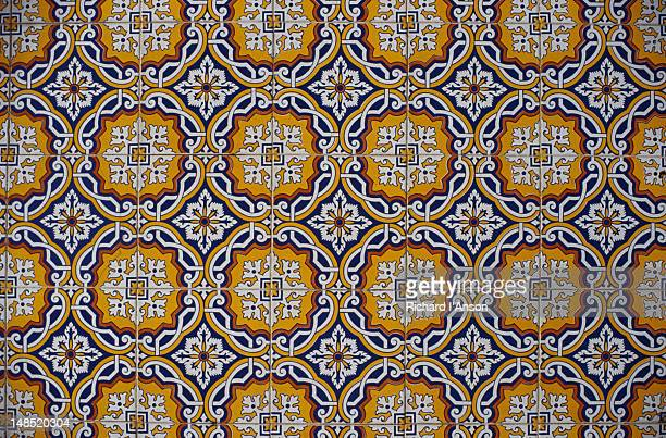Azulejos (hand painted tiles) decorating shop wall.