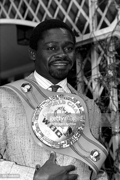 Azumah Nelson shows off the WBC World Championship belt which he retained in twelve rounds against Jim McDonnell