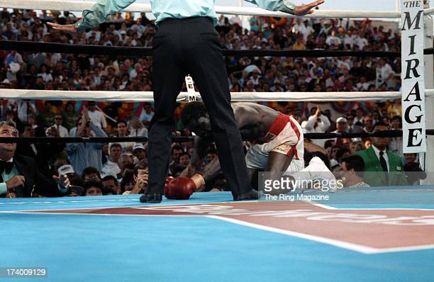 Azumah Nelson tries to get up during the fight against Jeff Fenech at the Mirage Hotel Casino in Las Vegas Nevada The WBC super featherweight title...