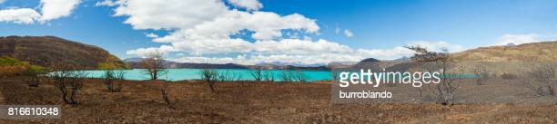Azure glacial lake Nordenskjold shines on a clear day along the full circuit hike around Torres Del Paine Chile, Patagonia, South America