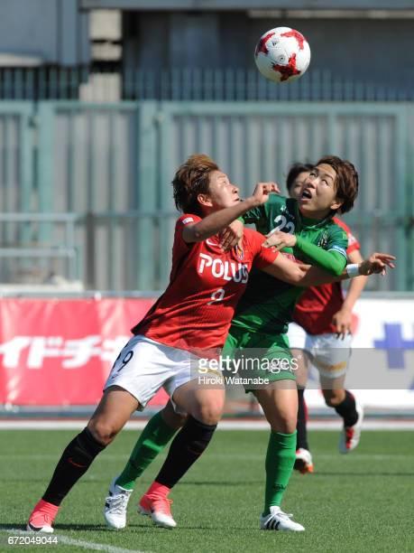 Azusa Iwashimizu of NTV Beleza and Yuika Sugawara of Urawa Red Diamonds Ladies compete for the ball during the Nadeshiko League match between Ladies...