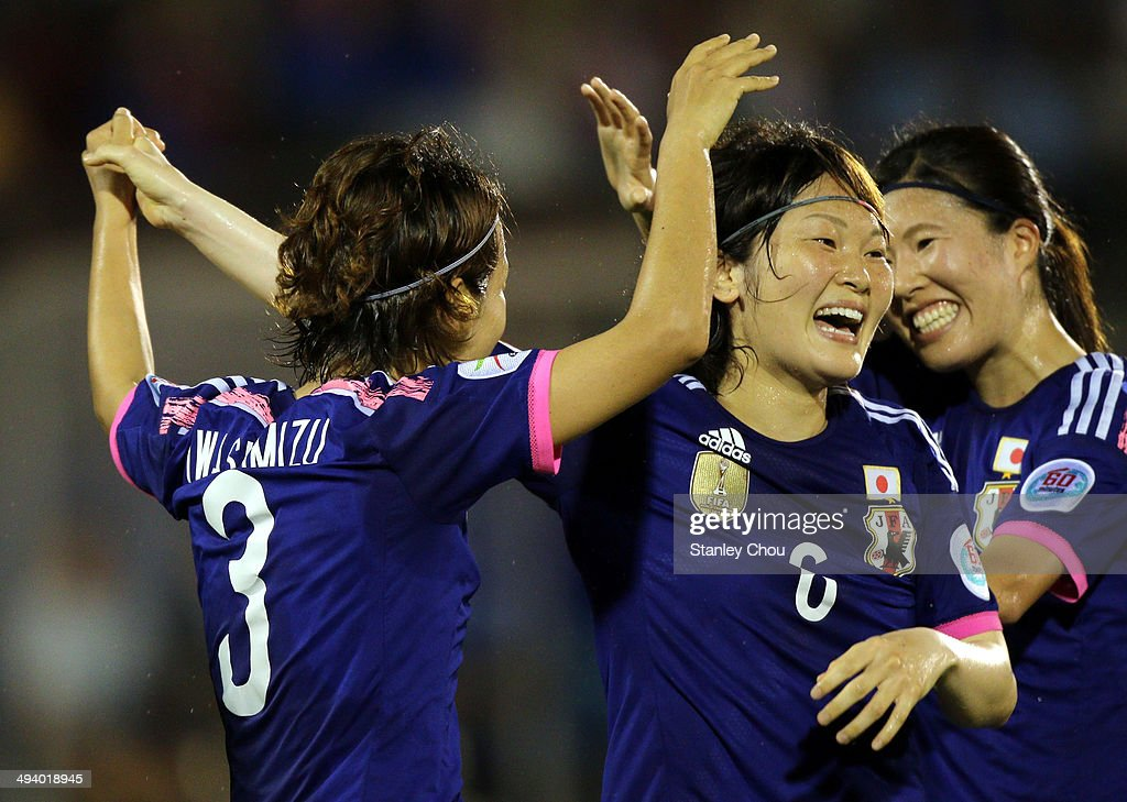 <a gi-track='captionPersonalityLinkClicked' href=/galleries/search?phrase=Azusa+Iwashimizu&family=editorial&specificpeople=4076079 ng-click='$event.stopPropagation()'>Azusa Iwashimizu</a>#3 of Japan celebrates with Sagaguchi Mizuho#6 after scoring the 1st goal against Australia during the AFC Women's Asian Cup Final match between Japan and Australia at Thong Nhat Stadium on May 25, 2014 in Ho Chi Minh City, Vietnam.