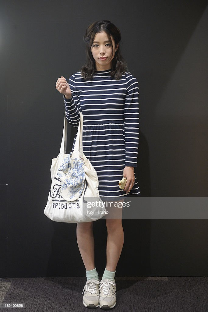 Azusa Katakura wears a dress by OPENING CEREMONY, shoes by New Balance and carries a bag by Theater Product at Mercedes-Benz Fashion Week Tokyo Spring/Summer 2014 on October 14, 2013 in Tokyo, Japan.
