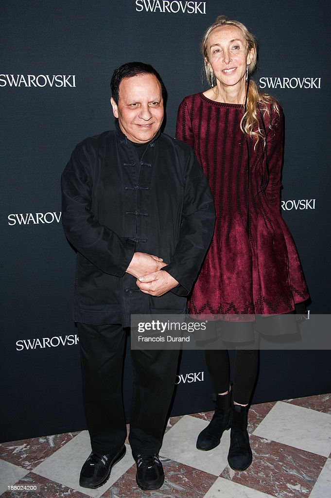 Azzedine Alaia and Carla Sozzani attend the Swarovski Dinner In Honor of the Bouroullec Brothers at Chateau de Versailles on November 14, 2013 in Versailles, France.
