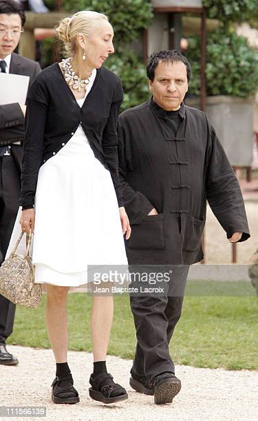 Azzedine Alaia and guest during Paris Haute Couture Fashion Week Fall/Winter 2005 Christian Dior Arrivals at Polo de Paris in Paris France