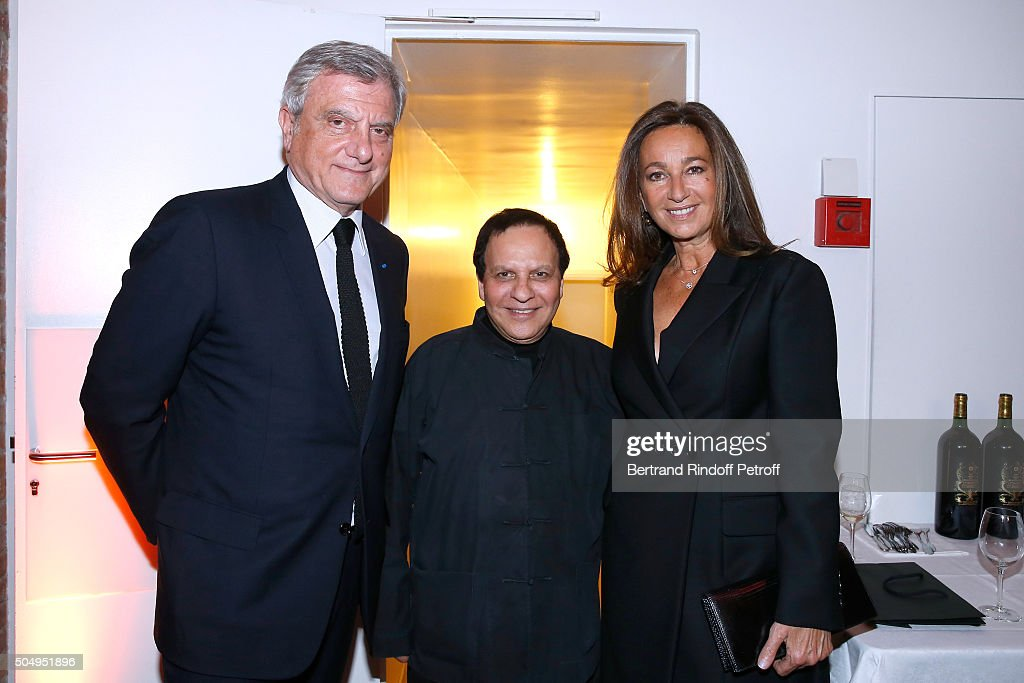 Azzedine Alaia standing between CEO Dior Sidney Toledano and his wife Katia Toledano attend the 'Jean Nouvel and Claude Parent, Musees a venir' Exhibition Opening at Galerie Azzedine Alaïa on January 13, 2016 in Paris, France.