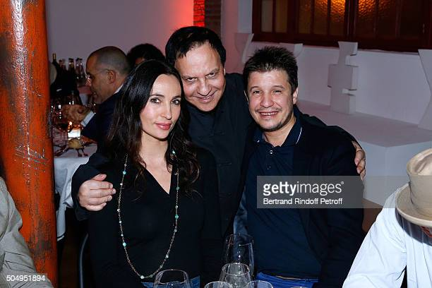 Azzedine Alaia standing between Contemporary artist Adel Abdessemed and his wife Julie attend the 'Jean Nouvel and Claude Parent Musees a venir'...