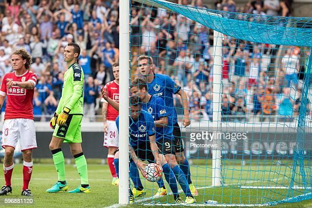 b09 Jelle Vossen forward of Club Brugge b04 Bjorn Engels defender of Club Brugge s28 Guillaume Hubert goalkeeper of Standard Liege during the Jupiler...