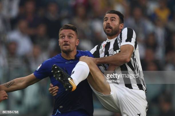 b15fights for the ball against Lazio midfielder Sergej MilinkovicSavic during the Serie A football match n8 JUVENTUS LAZIO on at the Allianz Stadium...