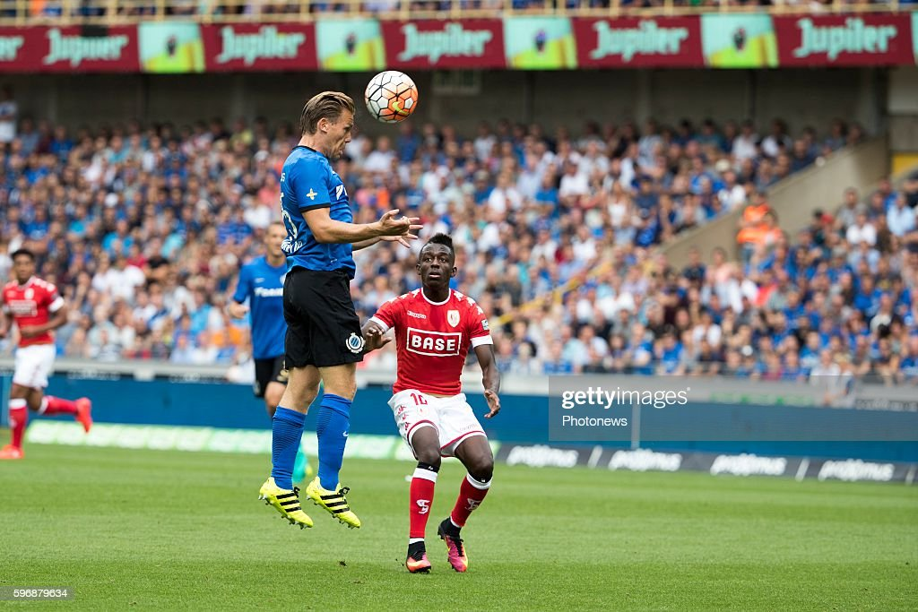 b25 Ruud Vormer midfielder of Club Brugge s10 JeanLuc Diarra Dompe midfielder of Standard Liege during the Jupiler Pro League match between Club...