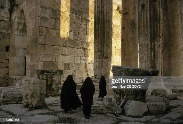 Baalbek Lebanon in 1993 Veiled women walking among the Corinthian columns of the temple of Bacchus