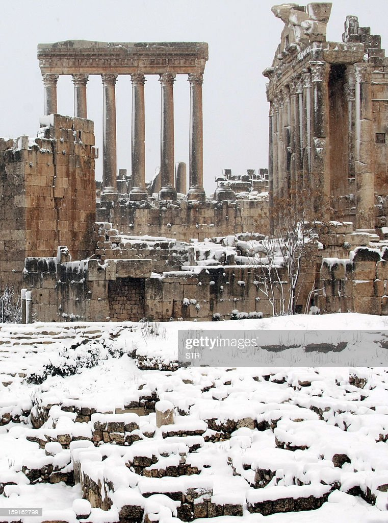 Baalbek's Bachus (R) and Jupiter (L) temples are pictured on January 9, 2013 as the Roman ruins of the historic town in eastern Lebanon's Bekaa Valley were covered with snow, following a fierce storm which has whipped the region this week with temperatures dropping dramatically and snow falling on low levels across Lebanon, Syria, Jordan and Israel. AFP PHOTO/STR