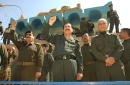 Baath Party officials watch over a demonstration against an Americanled war in Iraq and in favor of the regime of Saddam Hussein March 15 2003 in the...