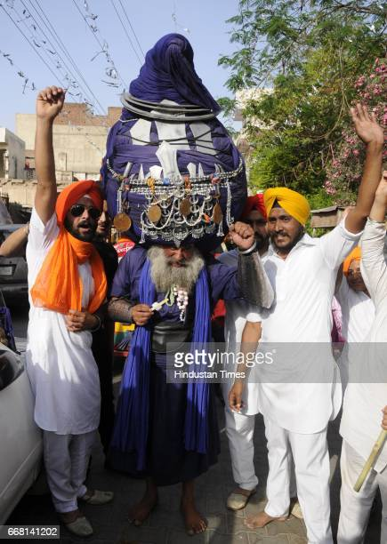 Baba Balwant Singh famous for wearing 800 meters turban at Nagar Kirtan on the occasion of Baisakhi festival on April 13 2017 in Patiala India...