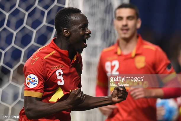 Baba Diawara of Adelaide United celebrates scoring a goal during the AFC Champions League Group H match between Gamba Osaka v Adelaide United at...