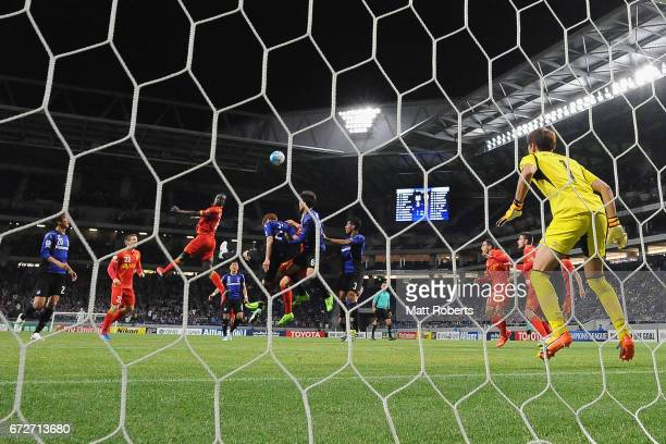 Baba Diawara of Adelaide United heads the ball in for a goal during the AFC Champions League Group H match between Gamba Osaka v Adelaide United at...