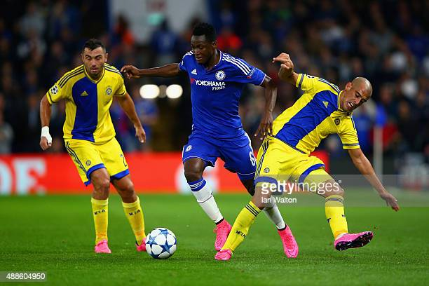 Baba Rahman of Chelsea is tackled by Tal Ben Haim II of Maccabi Tel Aviv during the UEFA Chanmpions League group G match between Chelsea and Maccabi...