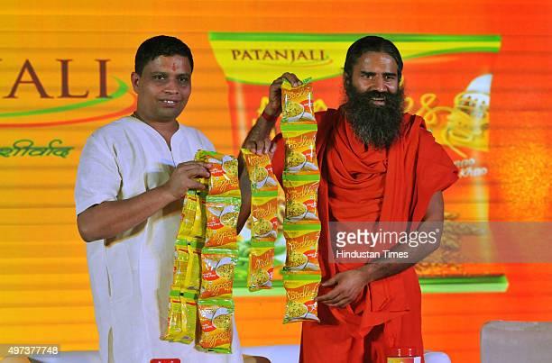 Baba Ramdev and Acharya Balkrishna launching Patanjali Atta Noodles on November 16 2015 in New Delhi India Baba Ramdevpromoted Patanjali launched its...