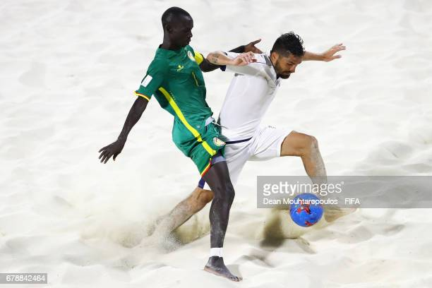 Babacar Fall of Senegal battles for the ball with Michele Di Palma of Italy during the FIFA Beach Soccer World Cup Bahamas 2017 quarter final match...