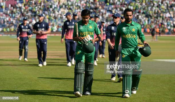 Babar Azam and Mohammad Hafeez of Pakistan lead the players off after the ICC Champions Trophy match between England and Pakistan at Swalec stadium...